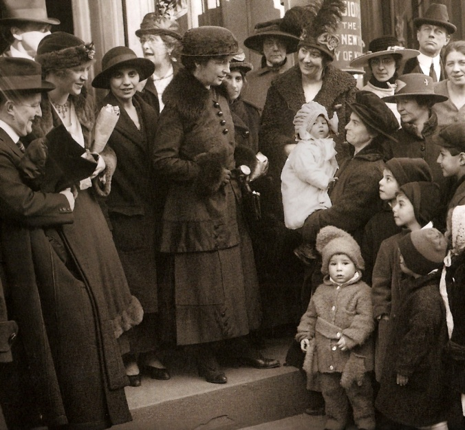 Margaret Sanger, surrounded by supporters on the steps of the Brooklyn Court of Special Sessions. The photo was taken during the Brownsville Clinic trials on January 7, 1917. The clinic, which Margaret Sanger opened at 46 Amboy Street in the Brownsville section of Brooklyn, was raided and closed after being open only nine days.